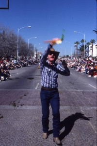 Daniel Buckley leads kazoo band in Tucson Rodeo Parade ca. 1983