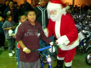 Santa Claus presents a bike / photo by Daniel Buckley