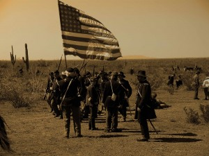 Union soldiers carry the American flag