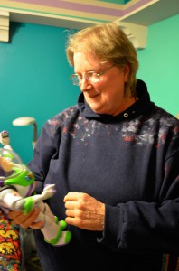 Former Persian Gulf air traffic controller Kellogg Patton with her Buzz Lightyear doll.