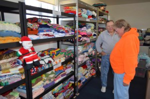 Quilter Kellogg Patton, foreground, drops of quilts to Prescott's Blankets 4 Kids program