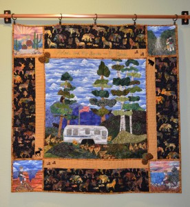 Quilt by Alicia Sterna shows her Airstream trailer, places she and her husband have been