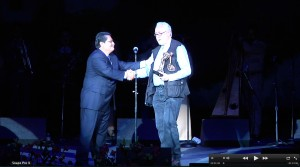 Tucson International Mariachi Conference president Alfonso Dancil inducts Daniel Buckley into the Mariachi Hall of Fame at the 2013 Espectacular Concert.
