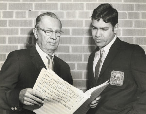Randy Carrillo, right, goes over music with Los Changuitos Feos music director Art Pepin in the late 1960s.