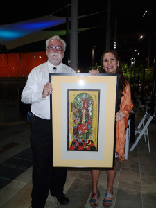 Buckley with artist Monica Aissa Martinez and her lithograph, Al Chemical Action, which came was part of  the award.