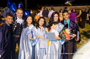 A group of 2014 Mariachi Aztlán de Pueblo High School graduates with director John Contreras following graduation.